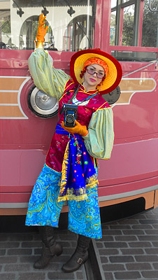 Flashy photographer lady by faded cable car