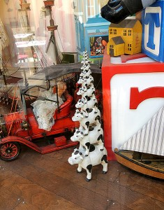 Traditional stack of cows in Disneyland shop window